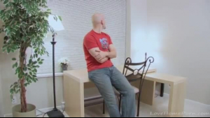 A bald man is getting a hot massage form a hot Japanese brunette who visits his office
