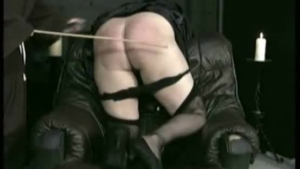 Black babe is kneeling on the floor and gently sucking her boyfriend's hard meat stick