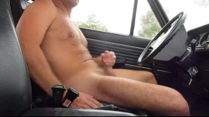 Blonde woman is sucking a taxi driver's dick before riding it on the back seat